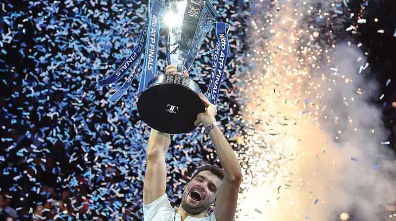 Grigor Dimitrov celebrates winning the men's singles final against David Goffin in the ATP World Tour Finals tennis tournament at the O2 Arena in London on Sunday. Dimitrov won 7-5, 6-4, 6-3. (Photo: AFP )
