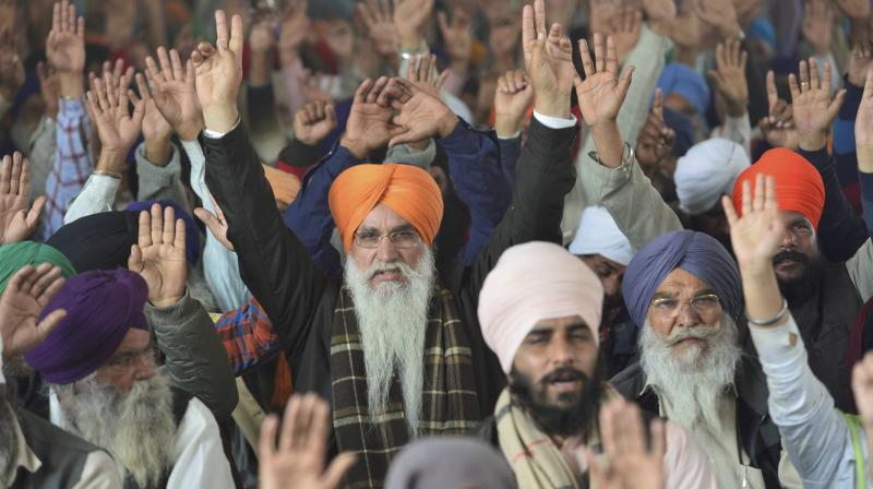 Farmers raise slogans during their ongoing protest at Singhu Border, in New Delhi, Tuesday, February 2, 2021. (PTI/Ravi Choudhary)