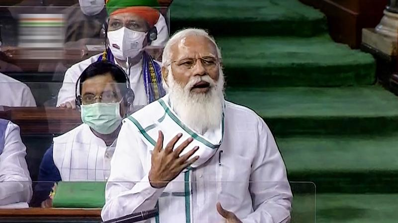 Prime Minister Narendra Modi speaks in the Lok Sabha, on the first day of the Monsoon Session of Parliament, in New Delhi, Monday, July 19, 2021. (LSTV/PTI Photo)