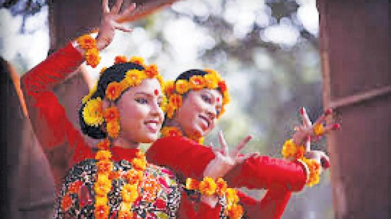 Girls perform a dance to celebrate the spring season