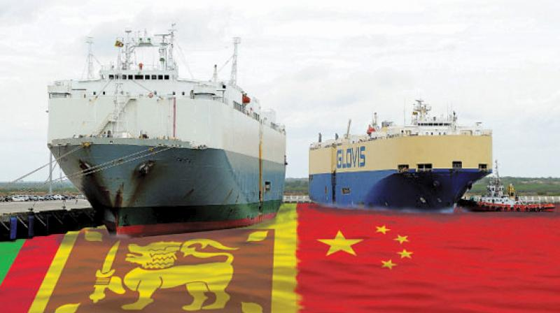 Two car-shipping carriers berthed at Sri Lanka's Chinese-built Hambantota Port. The first phase of the development cost $360 million and was 85 percent funded by the Export-Import Bank of China. (Photo: AFP)
