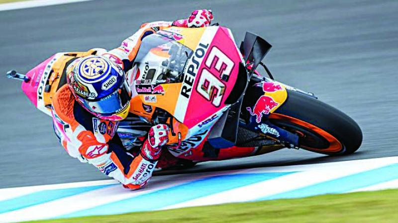 Spain's rider Marc Marquez of the Repsol Honda Team rides during a practice session at Japense Grand Prix on Friday.