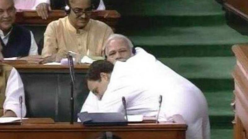 After finishing his speech on the no-confidence motion, Congress president Rahul Gandhi went over to where PM Narendra Modi was seated. After shaking his hand, Mr Gandhi hugged the Prime Minister in a spontaneous gesture, leaving the whole House stunned and smiling. (Photo: PTI)