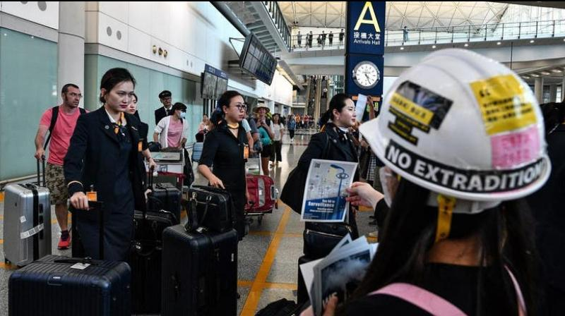 More than 100 flights were cancelled in Hong Kong on Monday morning with airport authorities warning passengers of potential disruption, as pro-democracy protesters kick off a city-wide strike. (Photo: AFP)