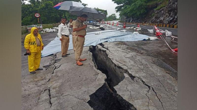 Traffic on the state highway connecting Mangalore to neighbouring states came to a halt on Tuesday after a huge crack developed in the road, due to incessant rains. (Photo: ANI)