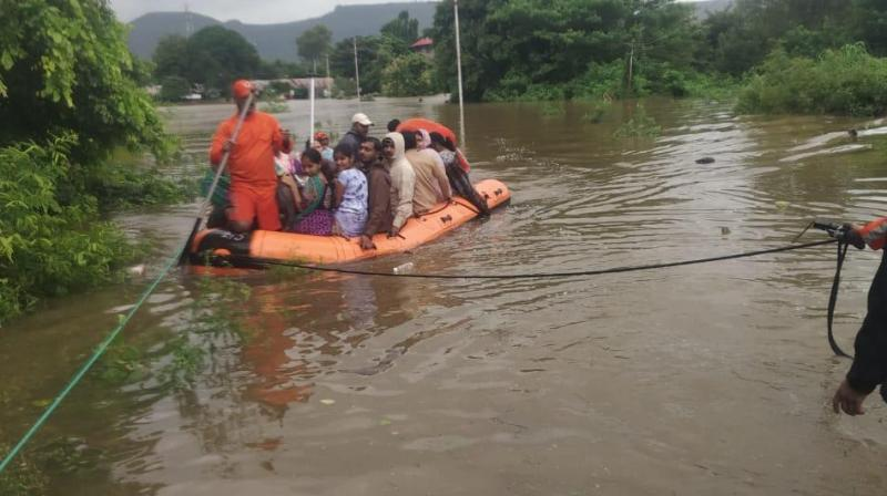 Five teams of National Disaster Response Force (NDRF) were airlifted from Punjab for the rescue operations in the flood-hit state of Maharashtra, sources said on Thursday. (Photo: Twitter/ ANI)