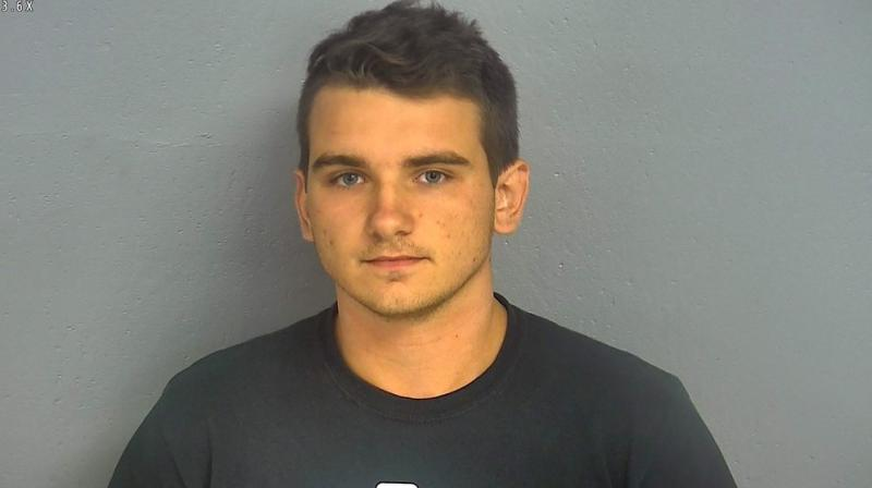 Prosecutors on Friday filed a terrorist threat charge against a 20-year-old man who said he walked into a Missouri store wearing body armor and carrying a loaded rifle and handgun to test whether Walmart would honour his constitutional right to bear arms. (Photo: AP)