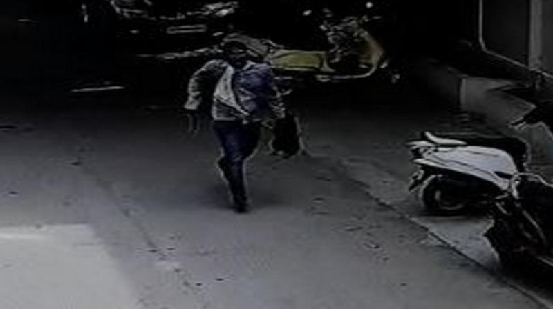 The whole incident was caught on CCTV camera, where the accused could be seen running with a sickle in one hand and the severed head in other. (Photo: ANI)