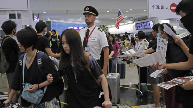 It came a day after authorities announced the unprecedented complete cancellation of all arriving and departing flights over a massive rally. (Photo: AP)