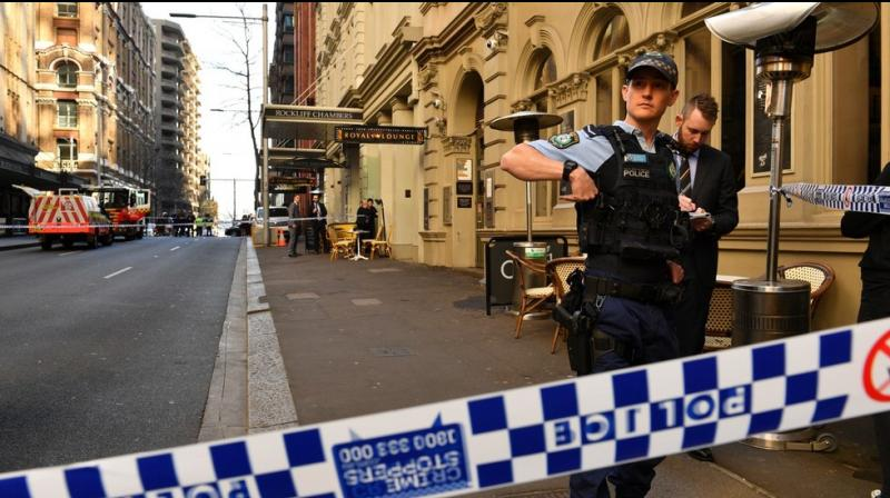 A man brandishing a large knife chased passersby in Sydney's Central Business District on Tuesday and stabbed at least one woman on the busy street before he was overpowered and taken into custody. (Photo: AFP)
