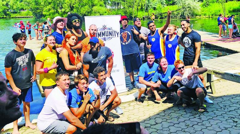 WWE star Becky Lynch and Ali pose with rowers from the Ontario Special Olympics after the dragon boat race during a community call at Ashbridge's Bay in Toronto.