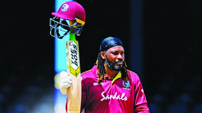 Chris Gayle  acknowledges the crowd as he walks back to the pavilion. (Photo: AFP)