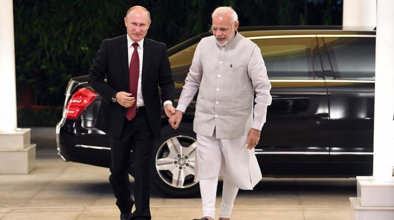 PM Modi and Russian president Vladimir Putin are expected to review bilateral defence cooperation in the wake of the US sanctions against Russian defence majors. (Photo: Twitter | @narendramodi)