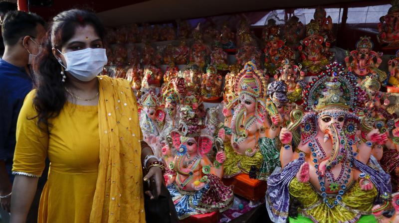 Customers look for idols of elephant-headed Hindu god Ganesha at a roadside studio in Kolkata, India. (AP)