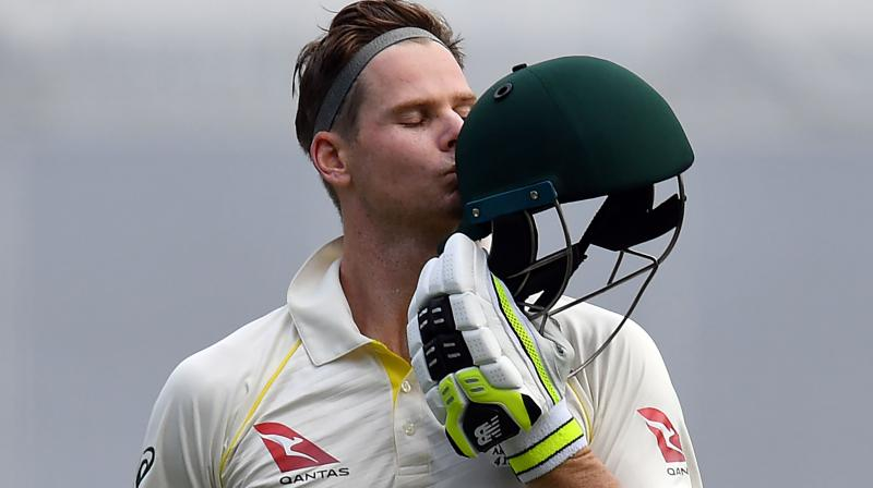 Smith, who began the day on 64, moved slowly but purposefully towards his century and soaked up eight successive dot balls when on 97 before Broad finally gave an opening. (Photo: AFP)