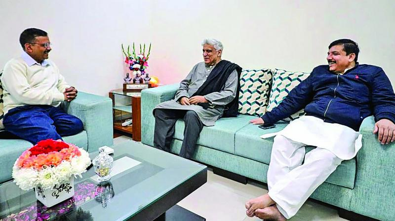 Delhi chief minister Arvind Kejriwal meets veteran writer-lyricist Javed Akhtar at his residence in New Delhi. AAP leader Sanjay Singh is also seen. 	(Photo: PTI)
