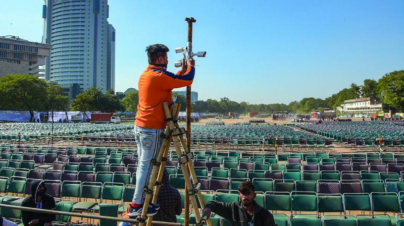 A worker installs CCTV cameras at Ramlila Maidan in New Delhi on Friday. (Photo: PTI)