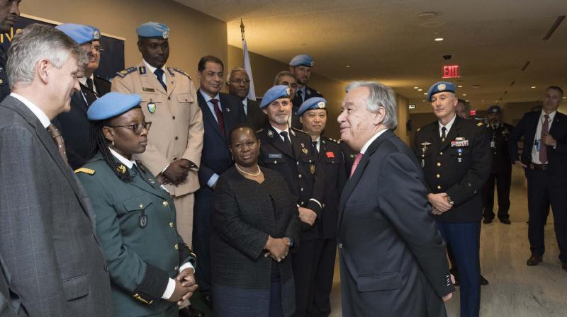 United Nations Secretary-General António Guterres interacts with peacekeeping forces. Every day, women and men who serve under the UN flag put their lives on the line, protecting millions of civilians at risk, supporting fragile political processes and sustaining peace.