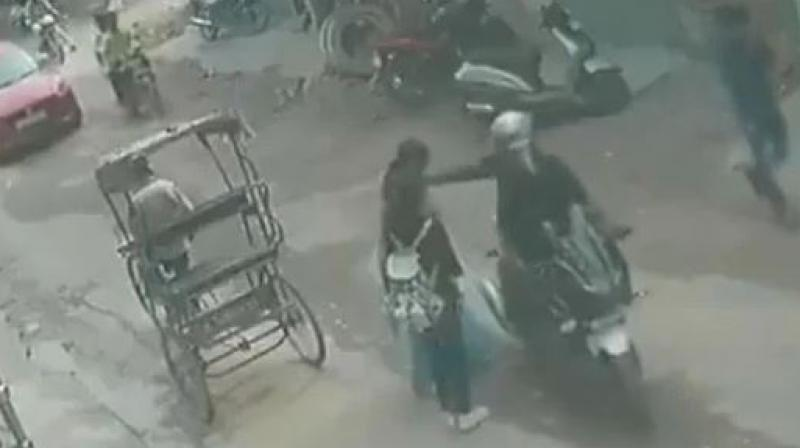 According to the police, the two identified as Abdul Shamshad and Vikas Jain were arrested on the spot while snatching a gold chain from a woman's possession in bright daylight on August 30.  (Photo: ANI | Twitter)