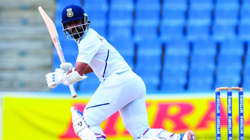 Ajinkya Rahane hits a boundary during Day Four of the first Test against West at Vivian Richards Cricket Stadium in North Sound, Antigua, on Sunday. (Photo: AFP)