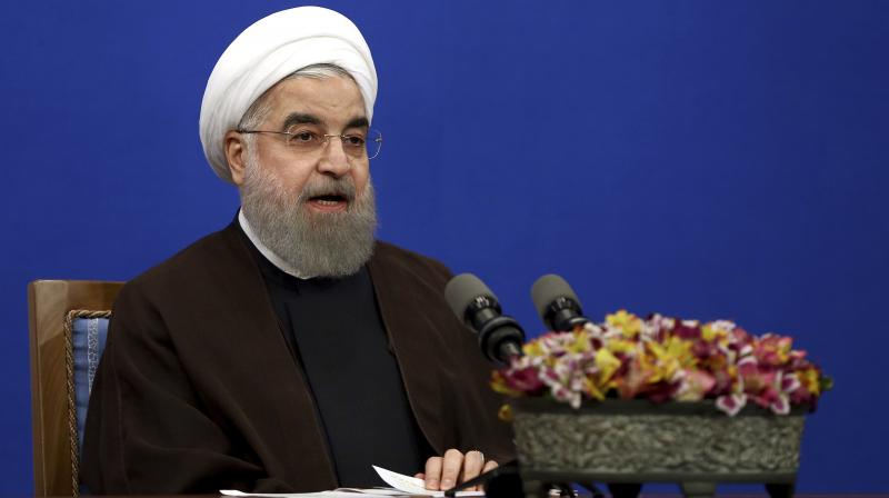 In Iran, Rouhani responded by ridiculing Trump, saying: 'You have no expertise in politics, nor in law, nor in international accords. A trader, a businessman, a high-rise builder, how can he judge about global issues?' (Photo: AP)