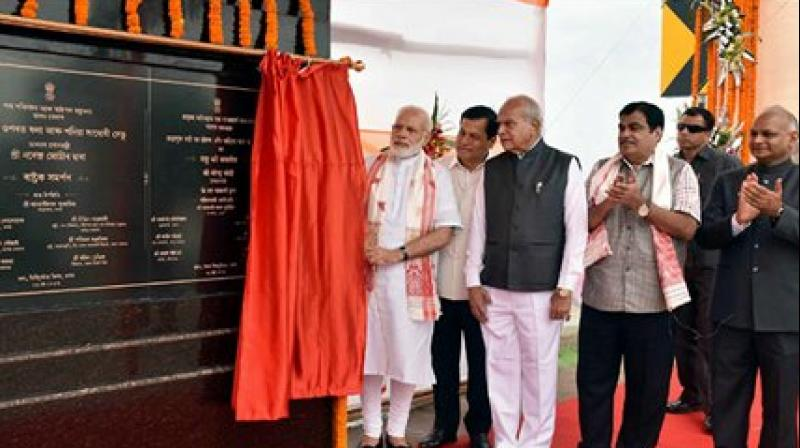 Prime Minister Narendra Modi unveiling the plaque to mark the dedication to the nation of the Dhola-Sadia Bridge, across River Brahmaputra, in Assam. Assam Governor Banwarilal Purohit, the Union Minister for Road Transport & Highways and Shipping Nitin Gadkari and the Chief Minister of Assam Sarbananda Sonowal are also seen. (Photo: PTI)