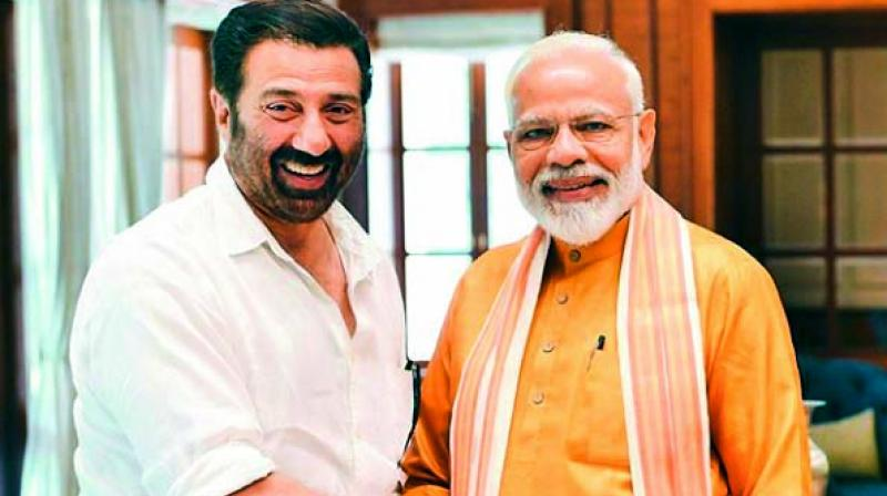 BJP candidate Sunny Deol with PM Modi. (Photo: Twitter)