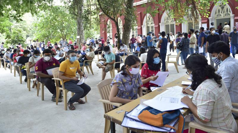 Students and citizens register for COVID-19 vaccine dose during a special vaccination drive for the people going abroad for education or employment, organised by the Karnataka government, in Bengaluru, June 22, 2021. (PTI/Shailendra Bhojak)