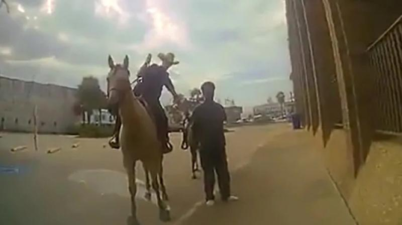 The bodycam videos, publicly released on Wednesday, shed additional light on the two officers' encounter with Neely as they took in him into custody using a procedure that mounted police in their department were trained to employ when no transport vehicle was available. (Photo: Screengrab)