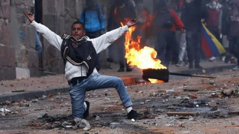 Police fired tear gas at protesters who threw stones and fire bombs close to the seat of government in the historic centre of the capital Quito. (Photo: AP)