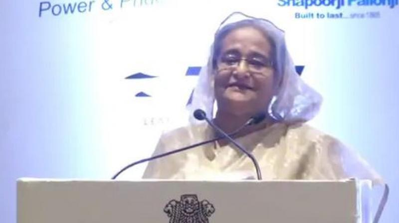 Hasina who is in Delhi to attend the India Economic Summit of the World Economic Forum, pitched her country as a fast-growing economy and attractive business destination. (Photo: ANI)