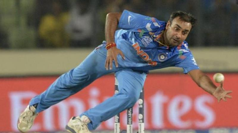 Amit Mishra took one wicket in the third T20 against England in Bengaluru. (Photo: AFP)