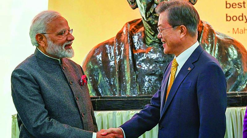 PM Narendra Modi and South Korean President Moon Jae-in after unveiling the bust of Mahatma Gandhi at the Yonsei University in Seoul on Thursday. (Photo: PTI)