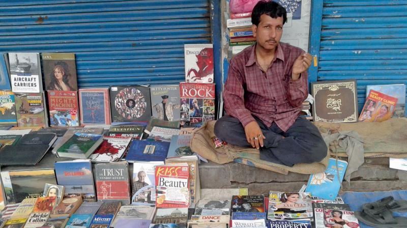 A bookseller in Daryaganj market.