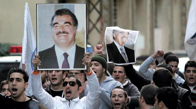Four alleged members of the Shiite Muslim fundamentalist group Hezbollah are on trial over the huge Beirut suicide bombing that killed Sunni billionaire Hariri and 21 other people. (AFP)