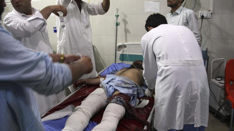 A wounded man receives treatment at a hospital after a suicide car bomb and multiple gunmen attack in the city of Jalalabad, east of Kabul, Afghanistan. (AP)