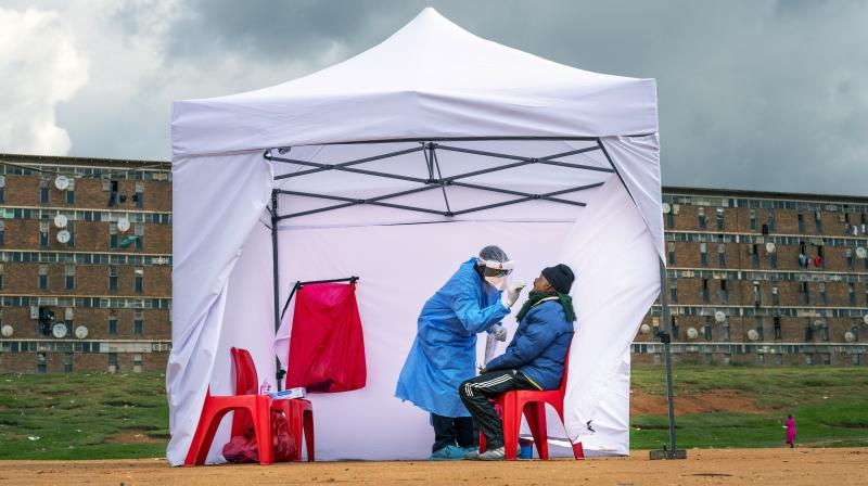 A resident from the Alexandra township gets tested for COVID-19 in Johannesburg, South Africa. (AP)