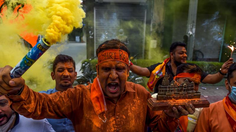 Bharatiya Janata Party (BJP) activists and supporters shout slogans as they celebrate before the groundbreaking ceremony of the Ram Temple in Ayodhya. (AFP)