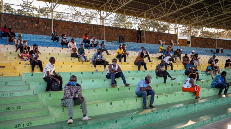 People who did not respect the measures to prevent the spread of the COVID-19 (novel coronavirus) pandemic, such as the correct wearing of masks in public places, are forced to sit and listen the prevention speeches for a few hours in Nyamirambo stadium in Kigali, Rwanda. (AFP)