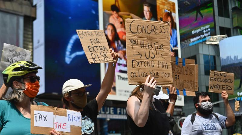 Protesters rally demanding economic relief during the coronavirus pandemic, at Time Square. (AFP)