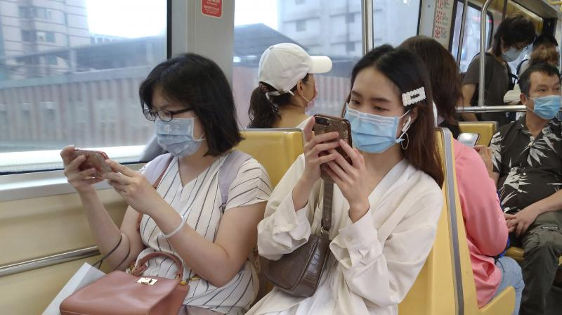 People riding the subway wear face masks to protect against the spread of the coronavirus in Taipei, Taiwan. (AP)