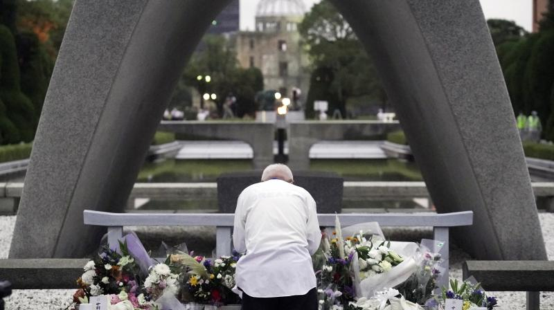 A man prays in front of the cenotaph for the atomic bombing victims before the start of ceremony to mark the 75th anniversary of the bombing in Hiroshima, western Japan. (AP)