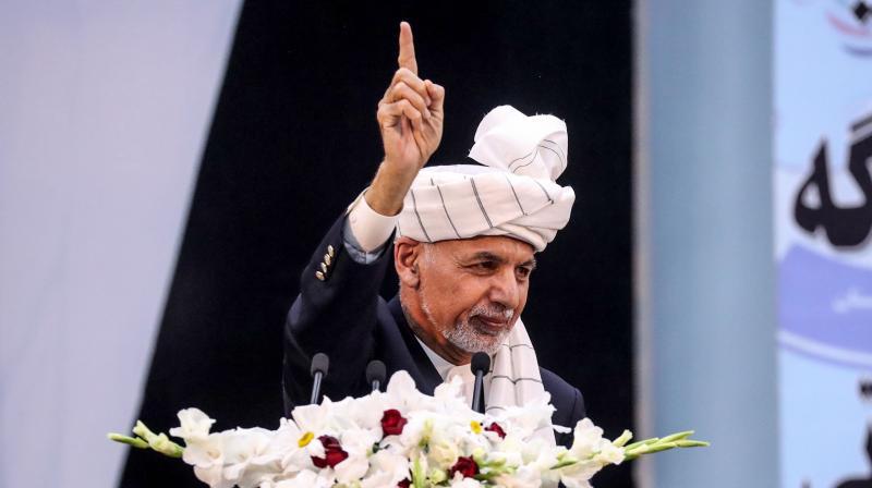 Afghan President Ashraf Ghani gestures as he speaks during the first day of the Loya Jirga, a grand assembly of Afghan elders, at the Loya Jirga Hall in Kabul. (AFP)