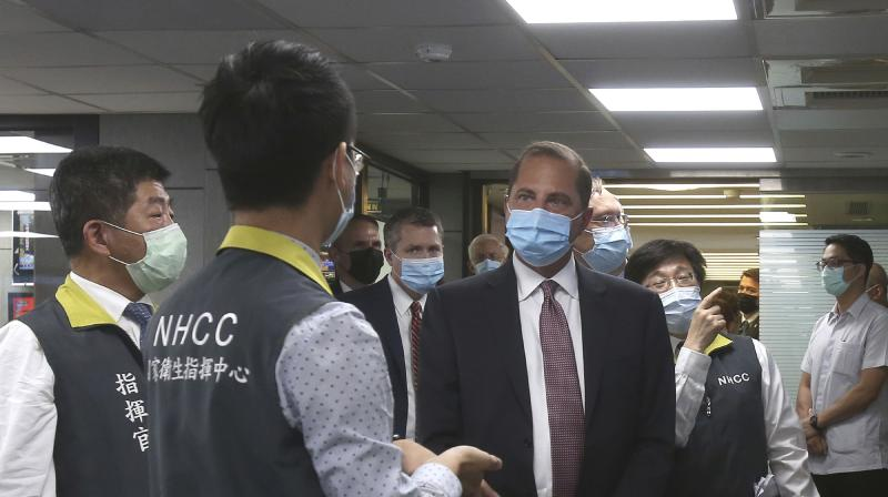 U.S. Health and Human Services Secretary Alex Azar (centre) visits the National Health Command Center with Taiwanese Minister of Health and Welfare Chen Shih-chung (left) at the Central Epidemic Command Center in Taipei, Taiwan. (AP)