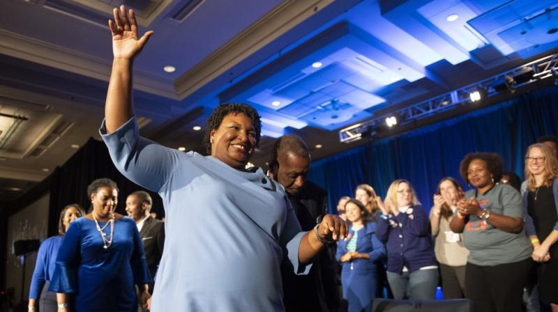 Georgia Democratic gubernatorial candidate Stacey Abrams leaves the stage after addressing supporters during an election night watch party in Atlanta.(AP)
