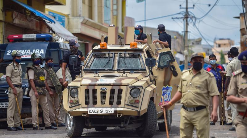 SWAT team patrol at the site of violence after a mob vandalised a police station and burnt vehicles over a social media post, allegedly by a relative of a Congress MLA, in Bengaluru. (PTI)