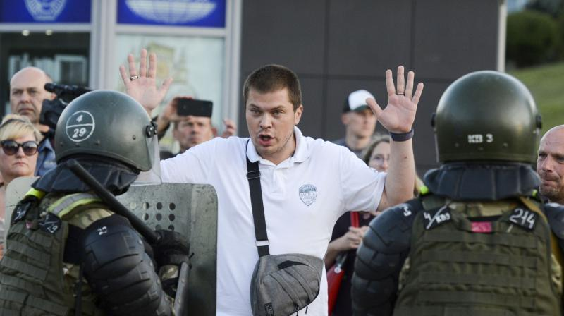 Police detain an opposition supporter protesting the election results as protesters encounter aggressive police tactics in the capital of Minsk, Belarus. (AP)