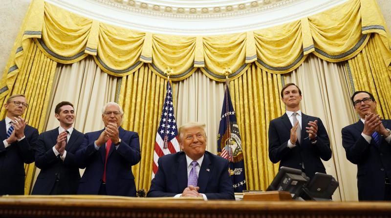 President Donald Trump is applauded after speaking in the Oval Office at the White House. (AP)