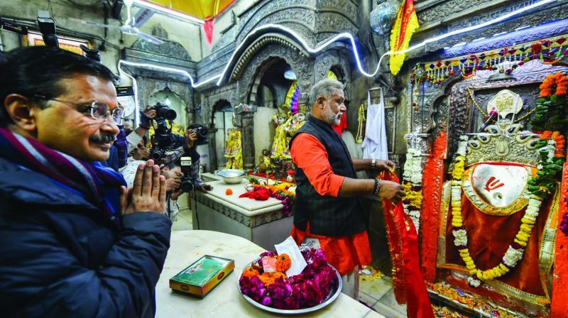 Delhi chief minister Arvind Kejriwal offers prayers at the Hanuman Mandir in New Delhi on Friday. (Photo: PTI)
