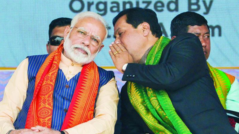 Prime Minister Narendra Modi with Assam chief minister Sarbanand Sonowal during a public meeting organised to celebrate the signing of the Bodo agreement. (Photo: PTI)